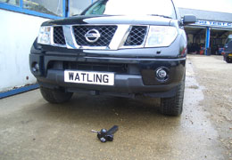 Front push towbar next to a Navara